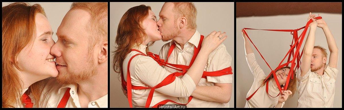 Пара снимает с себя красные ленты и радостно целуется.